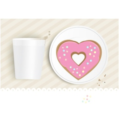 Pink heart shaped doughnut vector image