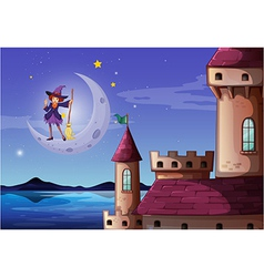 A witch with a broomstick standing near the castle vector image