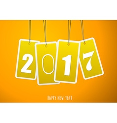 Four yellow hanging labels with 2017 year vector image