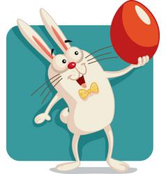 Happy bunny holding an easter egg cartoon vector