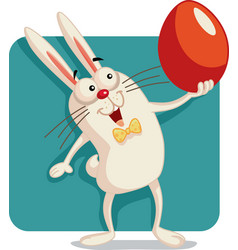 happy bunny holding an easter egg cartoon vector image