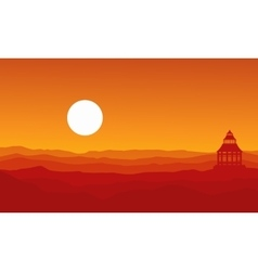 Silhouette of pavilion on desert landscape vector