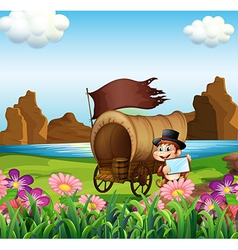 A monkey beside the wagon at the riverbank vector image