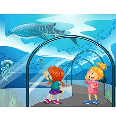 Two girls visiting aquarium vector image vector image