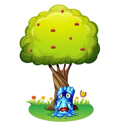 A sad monster under the cherry tree vector image