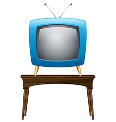 A blue television above the wooden table vector image
