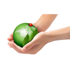 Green world and leaf have love bug in woman hands vector