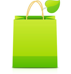 Green paper shopping bag with leaf on handle vector image vector image