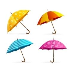 Realistic open colorful umbrellas set vector