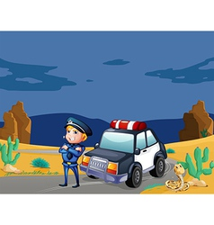 A smiling policeman beside the patrol car vector image
