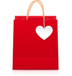 Red paper shopping bag with white heart label vector image