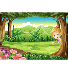 A young girl playing hide and seek at the forest vector image vector image