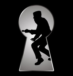 silhouette of a thief seen through a keyhole vector image vector image