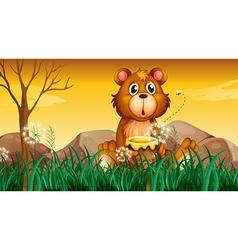 A cute bear holding a pot of honey vector image