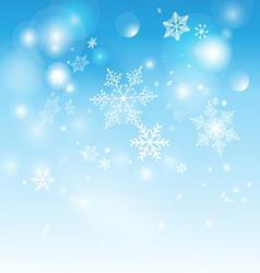Beautiful shimmering snowflakes on a blue vector image