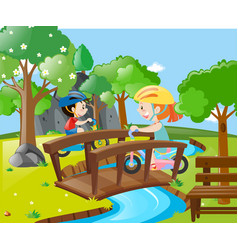 Two kids riding bike over the bridge vector
