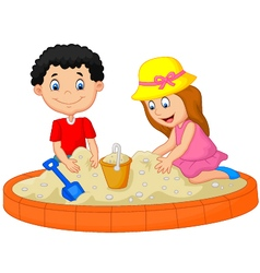 Kids playing on the beach building a sand castle d vector