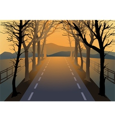 Empty road with dried trees by the roadside vector