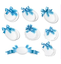 Set of christmas retro labels with blue gift bows vector