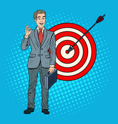 Pop art successful businessman achieved the target vector