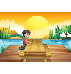 A table with bench near the river vector