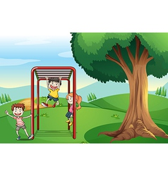 Kids playing near the tree vector image vector image
