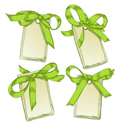 Tags with green bow vector