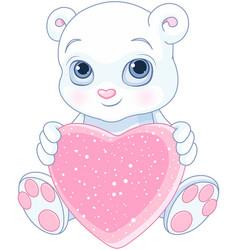 Teddy bear holds heart vector