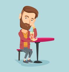 man drinking cocktail at the bar vector image