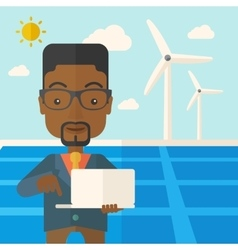 African man with laptop in solar panel vector