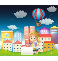 A girl holding an empty signboard near the tall vector image vector image