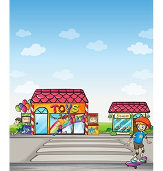 A boy skating in the street vector image