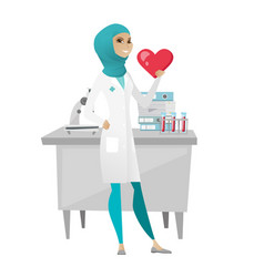 Muslim doctor holding a big red heart vector