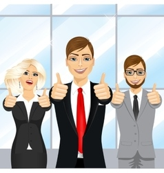 businessmen showing thumbs up in an office vector image