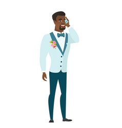 Groom talking on a mobile phone vector
