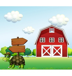A turtle with a wooden arrow board and a barn at vector