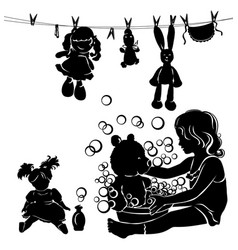 silhouette little girl washes toys vector image