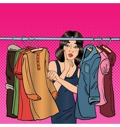 Woman choosing clothes in her wardrobe pop art vector