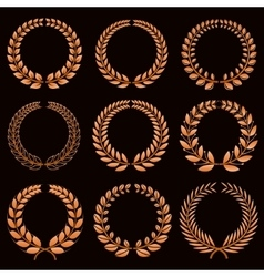 Winner labels with gold laurel wreaths set vector