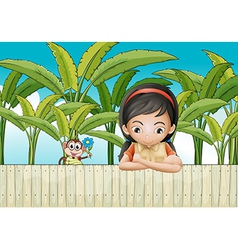 A sad girl leaning over the fence vector image vector image