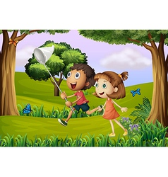 Two kids playing at the forest with a net vector image