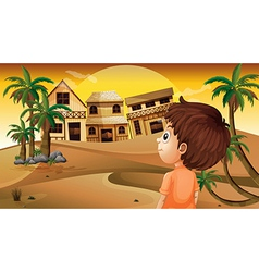A boy at the desert standing in front of the vector image vector image