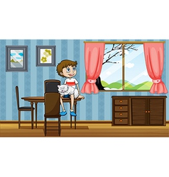 A boy sitting at the table with his cat vector image vector image