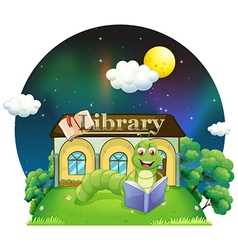A worm reading a book in front of the library vector image