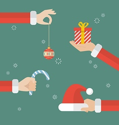 Santa claus hand holding christmas objects vector