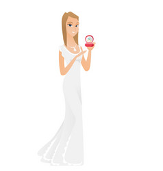 Young bride holding wedding ring in box vector