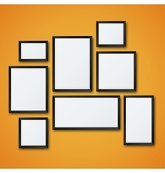 Blank picture frame set on orange wall vector