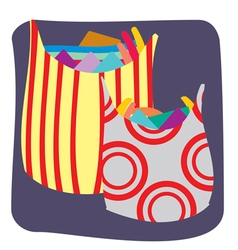 Plastic shopping bags full of clothes vector