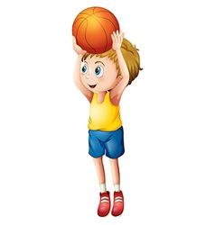 A cute boy playing basketball vector image
