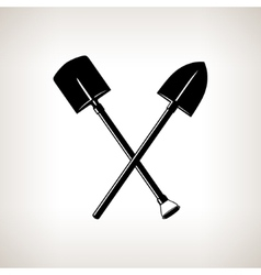 Silhouette of a crossed shovels vector